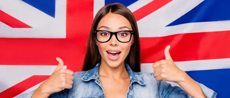 Happy girl on the background of the English flag